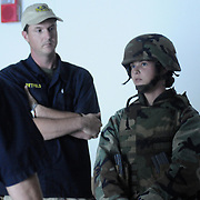 October 29, 2008 -- GULFPORT, Miss. -- Expeditionary Combat Skills School (ECS) Instructors interrogate U.S. Navy Master-at-Arms 3rd Class Danielle Panting about her conduct while shooting with the FATS trainer, a video-based system designed to teach quick action under combat pressure as part of the last phase of ECS.  The ECS school is designed to build a basic level of battlefield competence for sailors from the Navy's newly formed Expeditionary Combat  Combat Command  (NECC) community. The students have a wide range of precision modern warfare skills. Because the Navy is supporting missions ashore more than ever, there is a significant need for sailors to gain land-based combat skills. The aim of the school is to provide NECC sailors basic warfighting and survival capabilities. Photo by Mass Communication Specialist 1st Class Roger S. Duncan.  (RELEASED)