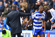 Yakou Meite (21) of Reading is patted on the back by Reading manager Jose Gomes as he comes off after being substituted during the EFL Sky Bet Championship match between Reading and Brentford at the Madejski Stadium, Reading, England on 13 April 2019.