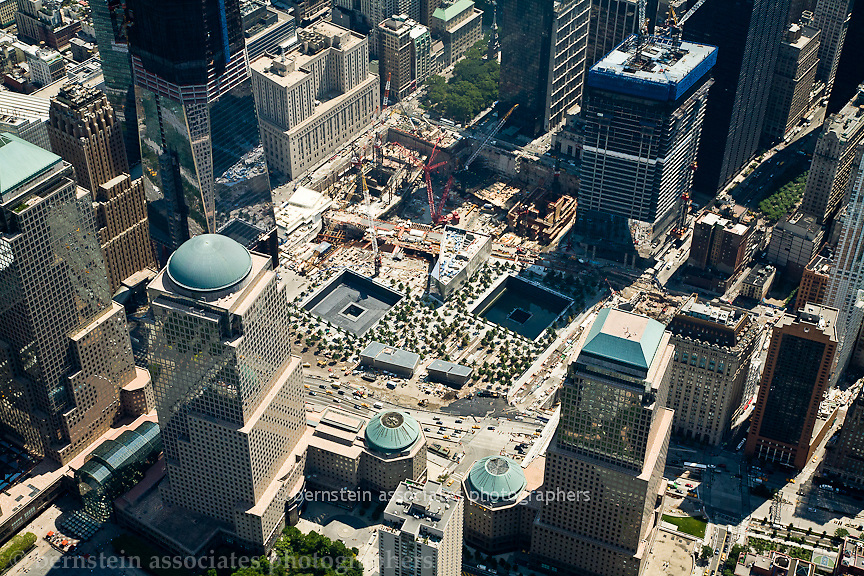 Aerial photos of the Ground Zero.  Site of the World Trade Center, twin towers.  New reflecting pools and the Freedom Towers.