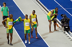 Asafa Powell, Michael Frater, Steve Mullings and Usain Bolt of Jamaica celebrate winning the gold medal in the mens 4x100 Metres Relay Final with mascot Berlino during day eight of the 12th IAAF World Athletics Championships at the Olympic Stadium on August 22, 2009 in Berlin, Germany. (Photo by Vid Ponikvar / Sportida)