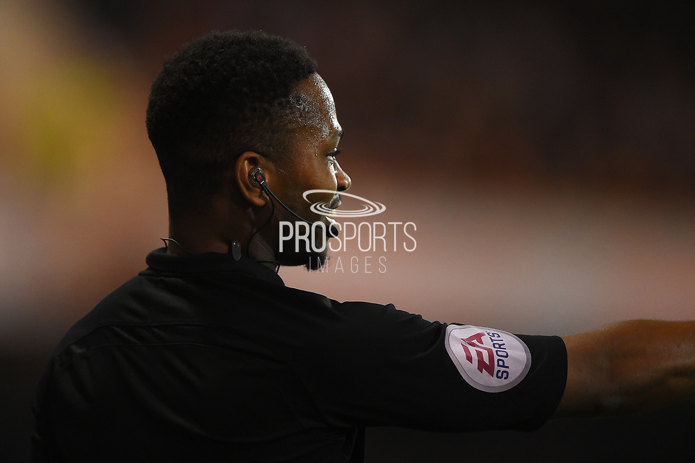 Assistant Ref Akil Howson smiles as the Forest supports cheer his decision during the EFL Sky Bet Championship match between Nottingham Forest and Fulham at the City Ground, Nottingham, England on 26 September 2017. Photo by Jon Hobley.