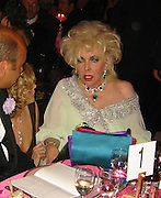 Meg Ryan adn Elizabeth Taylor..**EXCLUSIVE**.2003 amFAR Cinema Against Aids-Cannes Film Festival.Moulin de Mougins..Thursday, May 22, 2003..Mougins, France..Photo By Celebrityvibe.com.To license this image please call (212) 410 5354; or .Email: CelebrityVibe@gmail.com ; .website: www.CelebrityVibe.com.**EXCLUSIVE**