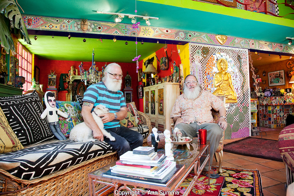 San Miguel de Allende, Guanajuato, Mexico:  Anado McLauchlin, left, and his husband Richard Schultz in the living room of their the eclectic home. On their coffee table sit the wedding cake dolls used at their wedding. The interior of the house is covered in tile mosaic collages and decorated with McLauchlin's altars. Every wall and even ceilings are different colors. It is on an acre of land outside San Miguel Allende, Mexico. June 2009. (photo: Ann Summa)..