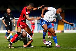 Tom Ince of Huddersfield Town challenges Chris Humphrey of Bury - Mandatory by-line: Matt McNulty/JMP - 16/07/2017 - FOOTBALL - Gigg Lane - Bury, England - Bury v Huddersfield Town - Pre-season friendly