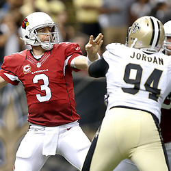 Sep 22, 2013; New Orleans, LA, USA; Arizona Cardinals quarterback Carson Palmer (3) throws against the New Orleans Saints during the second half of a game at Mercedes-Benz Superdome. The Saints defeated the Cardinals 31-7. Mandatory Credit: Derick E. Hingle-USA TODAY Sports