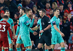 LIVERPOOL, ENGLAND - Saturday, December 29, 2018: Arsenal's Shkodran Mustafi argues with referee Michael Oliver after he awarded Liverpool a penalty during the FA Premier League match between Liverpool FC and Arsenal FC at Anfield. (Pic by David Rawcliffe/Propaganda)