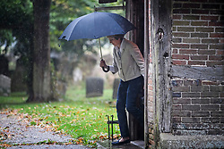 **2018 Pictures of the year by London News Pictures**<br /> © Licensed to London News Pictures. 22/09/2018. Prime Minister THERESA MAY is pictured carrying an umbrella as she leaves a church service with her husband Philip, near her constituency. The PM, who will face her party at Conservative Party conference next week, demanded 'respect' from EU leaders after they rejected her Chequers plan at a recent EU summit in Salzburg, Austria. Photo credit: Ben Cawthra/LNP