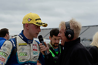 #1 Ashley Sutton Adrian Flux BMR Subaru Racing Subaru Levorg GT talking to Alan Hyde in post race interview during BTCC Race 2 Podium as part of the Dunlop MSA British Touring Car Championship - Rockingham 2018 at Rockingham, Corby, Northamptonshire, United Kingdom. August 12 2018. World Copyright Peter Taylor/PSP. Copy of publication required for printed pictures.