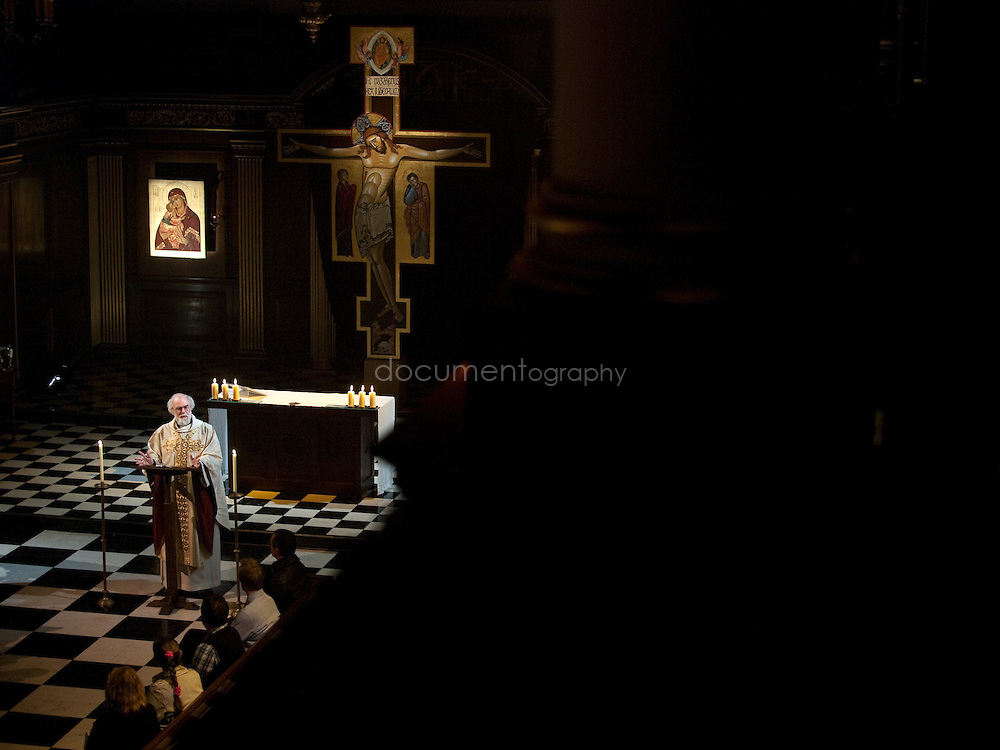 Archbishop of Canterbury, Rowan Williams during the blessing of an icon at St andrews  church in Holborn, london.
