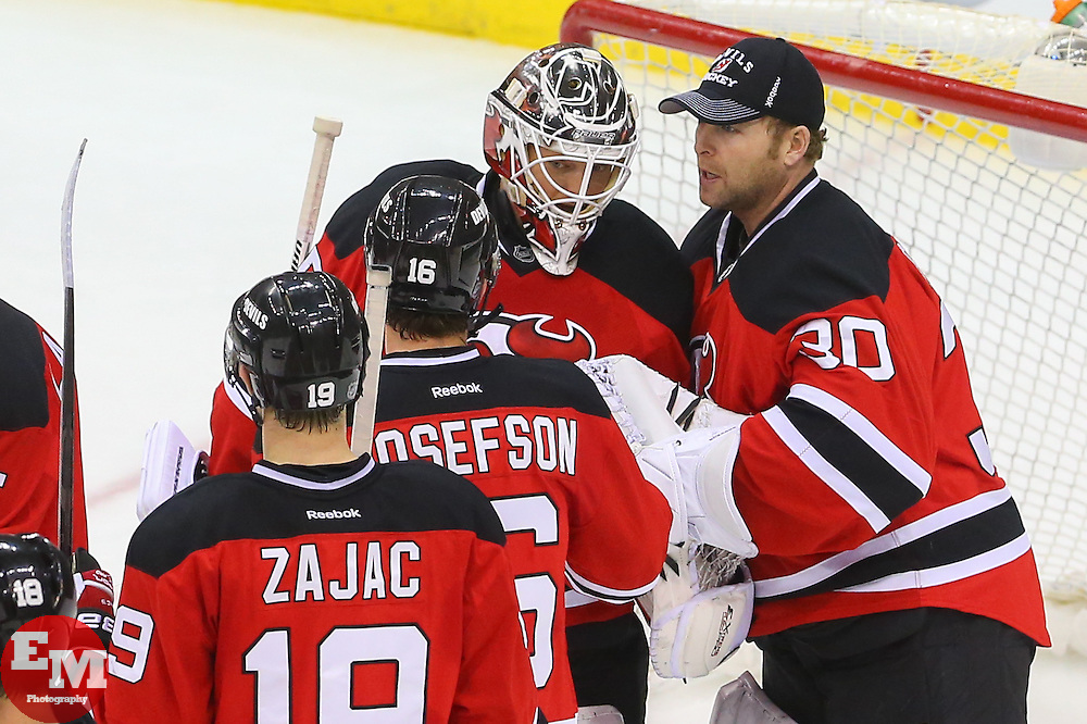 Mar 31, 2014; Newark, NJ, USA; New Jersey Devils goalie Martin Brodeur (30) congratulates New Jersey Devils goalie Cory Schneider (35) after the Devils 6-3 win over the Florida Panthers at Prudential Center.