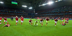 LILLE, FRANCE - Friday, July 1, 2016: Wales' Gareth Bale, goalkeeper Wayne Hennessey, Hal Robson-Kanu slide on the pitch as he celebrates after a 3-1 victory over Belgium and reaching the Semi-Final during the UEFA Euro 2016 Championship Quarter-Final match at the Stade Pierre Mauroy. (Pic by David Rawcliffe/Propaganda)