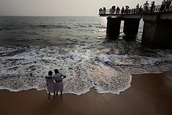 SRI LANKA COLOMBO 19MAR13 - Schoolgirls enjoy a moment on the beach at Galle Face Drive in Colombo, Sri Lanka. Colombo is the largest city and the commercial, industrial and cultural capital of Sri Lanka with a population of about 750,000 inhabitants.<br /> <br /> jre/Photo by Jiri Rezac<br /> <br /> © Jiri Rezac 2013