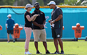 Miami Dolphins general manager Chris Grier speaks with United States women's national soccer team former coach Jill Ellis during Minicamp at the Baptist Health Training Facility at Nova Southeastern University, Tuesday, August 6, 2019, in Davie, Fla. (Kim Hukari/Image of Sport)