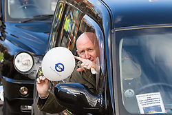 "Whitehall, London, February 10th 2016. A driver displays a white baloon emblazoned with ""TFL Totally Failing London"" as an estimated 8,000 cabbies hold a go-slow in protest against what they say is unfair competition from minicab and Uber drivers who do not have to undergo the rigorous training and checks required for the licenced taxi trade. ///FOR LICENCING CONTACT: paul@pauldaveycreative.co.uk TEL:+44 (0) 7966 016 296 or +44 (0) 20 8969 6875. ©2015 Paul R Davey. All rights reserved."