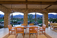 Dining table and chair in patio of luxury villa