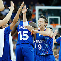 09 August 2012: France Celine Dumerc is congratulated by her teammates during 81-64 Team France victory over Team Russia, during the women's basketball semi-finals, at the 02 Arena, in London, Great Britain.