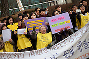 Protest of former comfort women and their supporters in front of the Japanese Embassy in the Korean capital Seoul. Former comfort women held their first protest rally in front of the Japanese Embassy in Seoul on Jan. 8, 1992, just before then-Japanese prime minister Kiichi Miyazawa visited Korea. The protests are held every Wednesday if rain or sunshine - they have gained international attention and become a living reminder of Japan's reluctance to atone for its past atrocities. Seoul, South Korea, Republic of Korea, KOR, 23rd of December 2009.