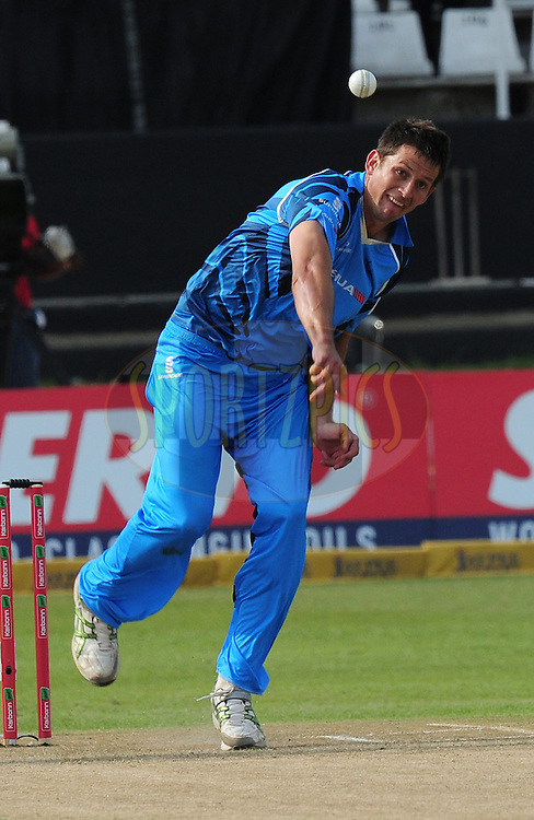 C J de Villiers bowling during match 8 of the Karbonn Smart CLT20 South Africa between The Titans and The Auckland Aces held at Kingsmead Park in Durban, South Africa on the 17th October 2012..Photo by Gerhard Duraan/SPORTZPICS/CLT20