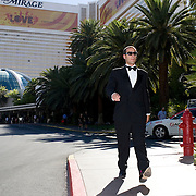 Jonathan Thompson walks past the Mirage hotel where he would enter his 3rd poker tournament, Las Vegas.