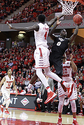 "20 March 2017: Tank Efianayi behind Daouda ""David"" Ndiaye (4) during a College NIT (National Invitational Tournament) 2nd round mens basketball game between the UCF (University of Central Florida) Knights and Illinois State Redbirds in  Redbird Arena, Normal IL"