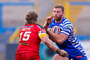 London Broncos interchange Edward Battye (15) stops Halifax RLFC prop Will Maher (17)  during the Betfred Championship match between Halifax RLFC and London Broncos at the MBi Shay Stadium, Halifax, United Kingdom on 8 April 2018. Picture by Simon Davies.