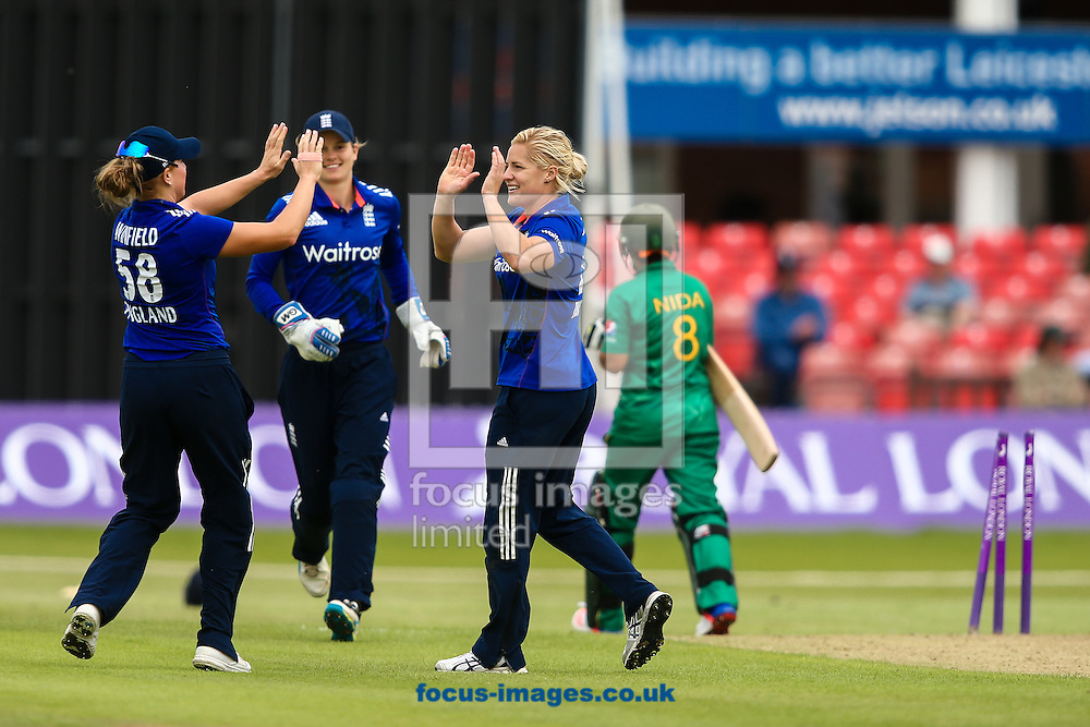 Nida Dar of Pakistan (right) is bowled by Katherine Brunt of England (2nd right) during the Royal London One Day Series match at Fischer County Ground, Leicester<br /> Picture by Andy Kearns/Focus Images Ltd 0781 864 4264<br /> 21/06/2016