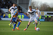 Sam Kelly of Port Vale FC holds off Abu Ogogo of Shrewsbury Town during the Sky Bet League 1 match between Shrewsbury Town and Port Vale at Greenhous Meadow, Shrewsbury, England on 25 March 2016. Photo by Mike Sheridan.