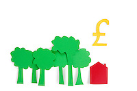 Conceptual shot of trees, residential house with a pound sign over white background
