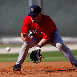 February 23, 2011; Fort Myers, FL, USA; Boston Red Sox third baseman Kevin Youkilis (20) during spring training at the Player Development Complex.  Mandatory Credit: Derick E. Hingle