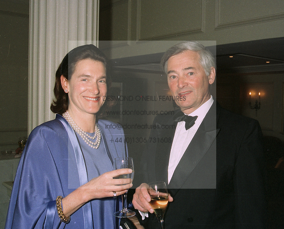 BARON & BARONESS FREDERICK VON OPPENHEIM  at a dinner in London on April 14th 1997.LXO 4