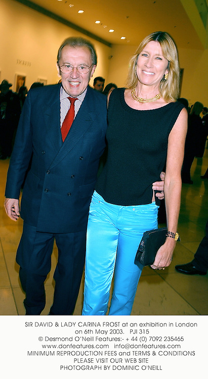 SIR DAVID & LADY CARINA FROST at an exhibition in London on 6th May 2003.			PJI 315