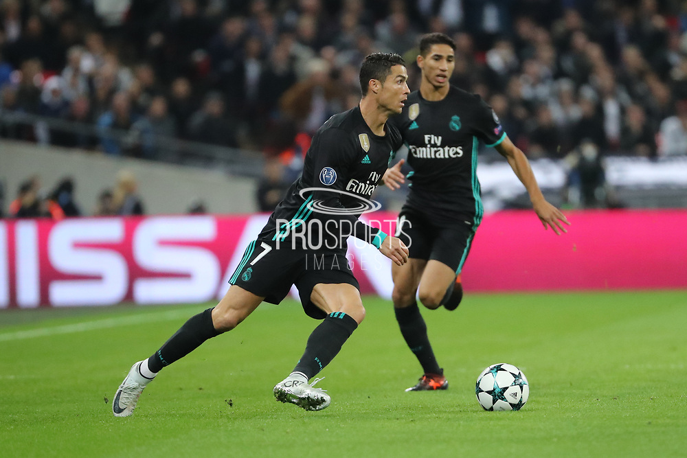 Real Madrid attaker Cristiano Ronaldo (7) dribbling during the Champions League match between Tottenham Hotspur and Real Madrid at Wembley Stadium, London, England on 1 November 2017. Photo by Matthew Redman.