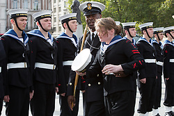 © licensed to London News Pictures. London, UK 20/10/2013. A Sea Cadet is taken off ill whilst standing for inspection in Trafalgar Square for the 2013 Trafalgar Day Parade in London. The Royal Navy's annual event, Trafalgar Day marks Lord Nelson's victory at the Battle of Trafalgar. Photo credit: Vickie Flores/LNP
