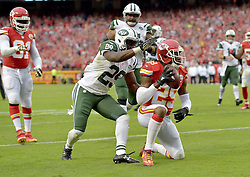 Sep 25, 2016; Kansas City, MO, USA; Kansas City Chiefs strong safety Eric Berry (29) kneels after intercepting a pass as New York Jets running back Bilal Powell (29) attempts the tackle during the second half at Arrowhead Stadium. The Chiefs won 24-3. Mandatory Credit: Denny Medley-USA TODAY Sports