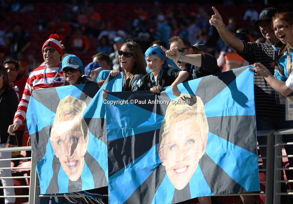 Carolina Panthers fans cheer as they hold up Ellen DeGeneres posters before the Carolina Panthers NFL Super Bowl 50 football game against the Denver Broncos on Sunday, Feb. 7, 2016 in Santa Clara, Calif. The Broncos won the game 24-10. (©Paul Anthony Spinelli)