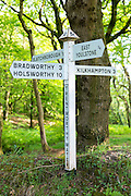 Traditional directional signpost to Bradworthy, Holsworthy, East Youlstone, Kilkhampton, Blatchborough in North Devon, UK