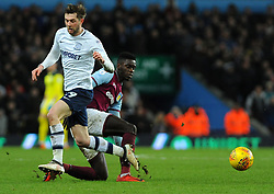 Axel Tuanzebe of Aston Villa tackles Tom Barkhuizen of Preston North End - Mandatory by-line: Nizaam Jones/JMP - 20/02/2018 - FOOTBALL - Villa Park - Birmingham, England - Aston Villa v Preston North End- Sky Bet Championship