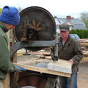 """Paul and Joe cutting properly angled pieces to make the frames for the hull. Paul tells me that """"frame"""" is the proper nautical term for what mostt folks would think of as a rib of the boat."""