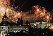 BARCELONA, SPAIN - AUGUST 9:  Fireworks burst in sky during the Closing Ceremony of the XXV Olympiad at the Montjuic Olympic Stadium (visible at upper right) on August 9, 1992 in Barcelona, Spain.  Building in left foreground is the National Museum of Catalan Art.  (Photograph by David Madison/Getty Images)