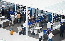 THEMENBILD, Airport Muenchen, Franz Josef Strauß (IATA: MUC, ICAO: EDDM), Der Flughafen Muenchen zählt zu den groessten Drehkreuzen Europas, rund 100 Fluggesellschaften verbinden ihn mit 230 Zielen in 70 Laendern, im Bild Passagiere bei der Sicherheitskontrolle // THEME IMAGE, FEATURE - Airport Munich, Franz Josef Strauss (IATA: MUC, ICAO: EDDM), The airport Munich is one of the largest hubs in Europe, approximately 100 airlines connect it to 230 destinations in 70 countries. picture shows: Passengers at the security checkpoint, Munich, Germany on 2012/05/06. EXPA Pictures © 2012, PhotoCredit: EXPA/ Juergen Feichter