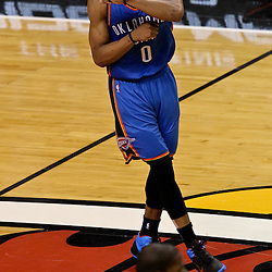 Jun 19, 2012; Miami, FL, USA; Oklahoma City Thunder point guard Russell Westbrook (0) react during the third quarter in game four in the 2012 NBA Finals against the Miami Heat at the American Airlines Arena. Mandatory Credit: Derick E. Hingle-US PRESSWIRE