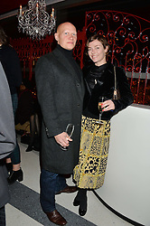 CAMILLA RUTHERFORD and DOMINIC BURNS at a party to celebrate the first anniversary of SushiSamba at the Heron Tower, 110 Bishopsgate, London EC4 on 12th November 2013.