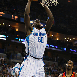 Mar 08, 2010; New Orleans, LA, USA; New Orleans Hornets center Emeka Okafor (50) goes in for a dunk over Golden State Warriors forward Chris Hunter (31) during the second half at the New Orleans Arena. Mandatory Credit: Derick E. Hingle-US PRESSWIRE