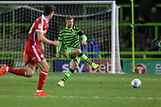 Forest Green Rovers Matt Mills(5) passes the ball forward during the EFL Sky Bet League 2 match between Forest Green Rovers and Scunthorpe United at the New Lawn, Forest Green, United Kingdom on 7 December 2019.