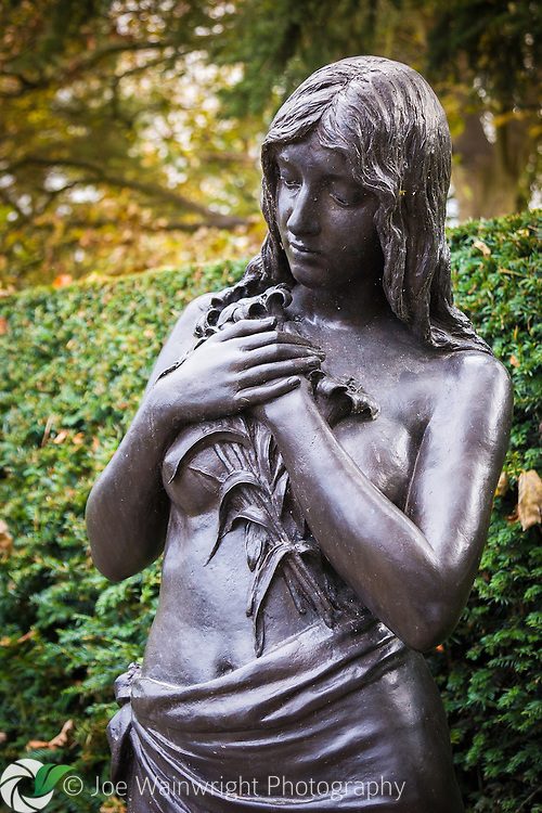 One of the four bronze nymphs by Andrea Carlo Lucchesi (1860 – 1924) that grace the gardens at Chirk Castle, near Wrexham, North Wales.  Photographed in November.