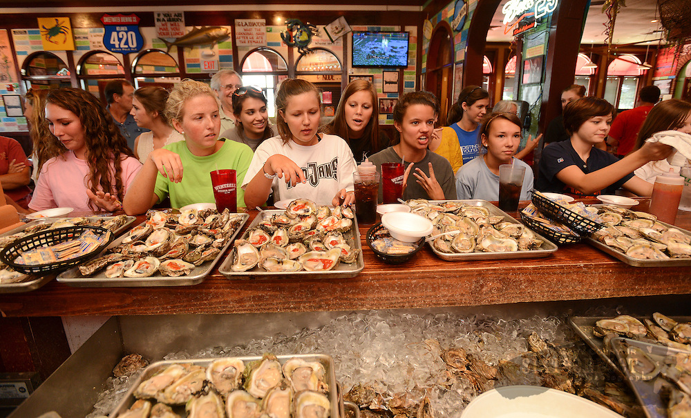 Photo by Gary Cosby Jr.     Distinguished Young Women of Morgan County candidates compete in a friendly oyster eating contest sponsored by Wintzell's Oyster House in Decatur Wednesday, August 1, 2012.  From left are Autumn Brooks, Lauren Speegle, Brooke Wilson, Courtney Turner, Mariana Threadgill and Morgan Hampton.  The Distinguished Young Women's competition will be held Saturday at 7pm at Austin High School.