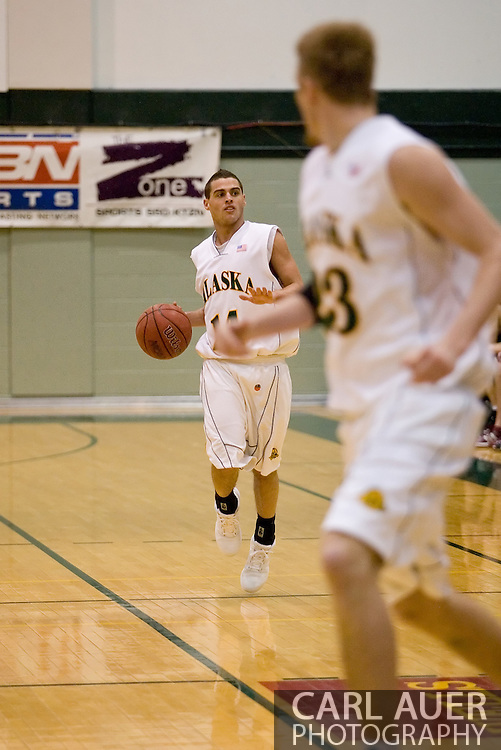 1/6/2006: Junior guard Luke Cooper (14) of the UAA Seawolves looks to the bench for a play as Anchorage goes on to beat the visiting Central Washington Wildcats, 80-60 at the Wells Fargo Sports Complex on the campus of UAA.<br />