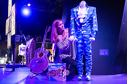 © Licensed to London News Pictures. 26/10/2017. London, UK. A curator makes adjustments a outfit worn by the musician Prince at the first ever exhibition about iconic superstar and legendary performer PRINCE showcases hundreds of never seen before artefact's directly from Paisley Park, Prince's famous Minnesota private estate. Photo credit: Ray Tang/LNP