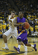 December 07 2010: Northern Iowa Panthers guard Kwadzo Ahelegbe (11) drives past Iowa Hawkeyes guard Eric May (25) during the first half of their NCAA basketball game at Carver-Hawkeye Arena in Iowa City, Iowa on December 7, 2010. Iowa defeated Northern Iowa 51-39.