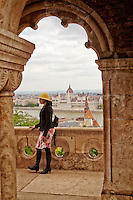 View of the Hungarian Parliament, a tourist, and the river Danube taken from the Fisherman's Bastion Terrace, Budapest, Hungary.
